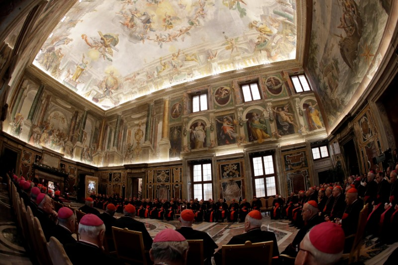 Pope Francis (L) speaks during the traditional greetings to the Roman Curia in the Sala Clementina (Clementine Hall) of the Apostolic Palace, at the Vatican