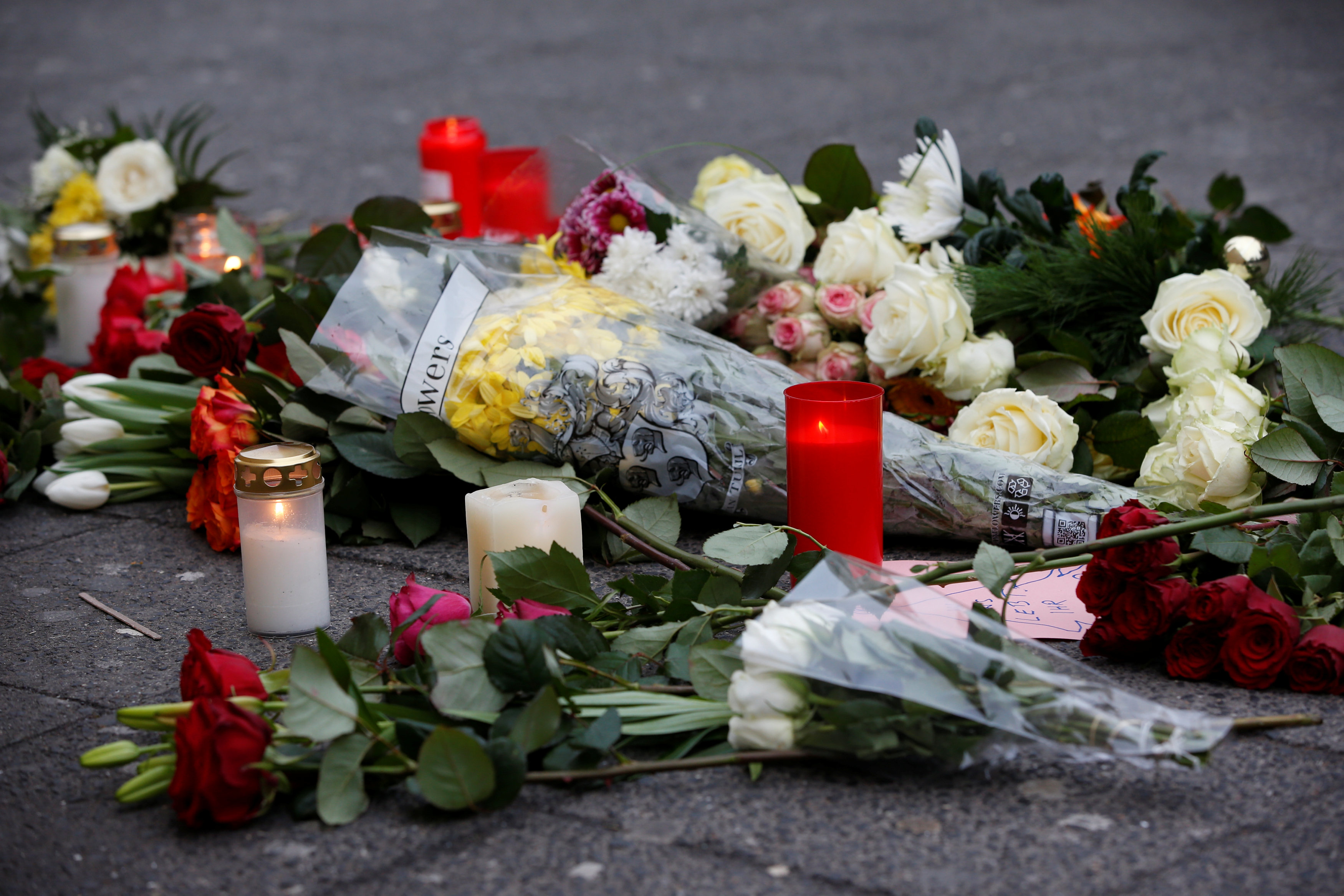 Flowers are seen near the scene where a truck ploughed into a crowded Christmas market in the German capital last night in Berlin, Germany,