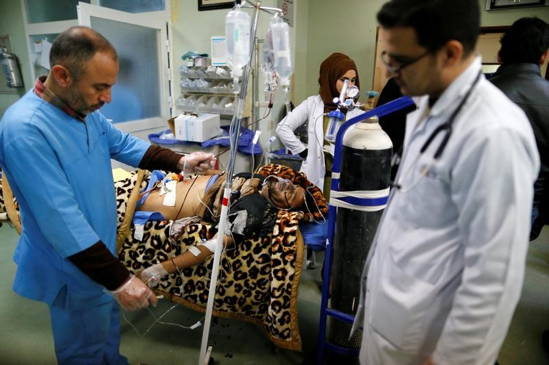 A man wounded in a bomb attack in Kokjali, receives treatment at a hospital in the northern Iraqi city of Erbil,
