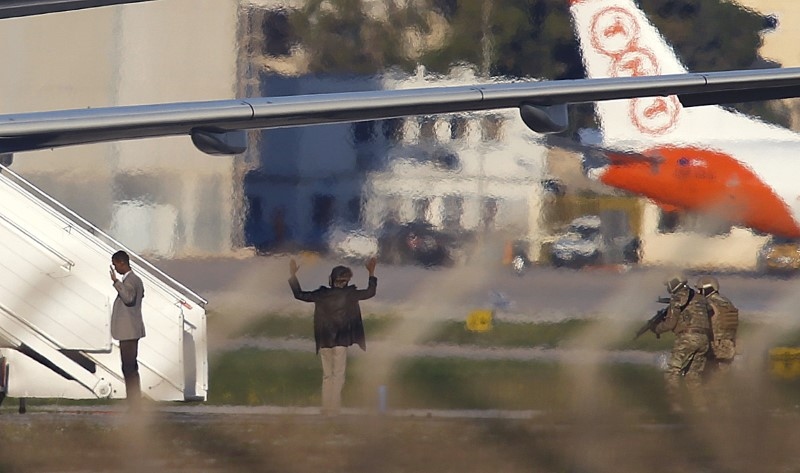 Two hijackers of a Libyan Afriqiyah Airways Airbus A320 surrender to Maltese military on the runway at Malta Airport,