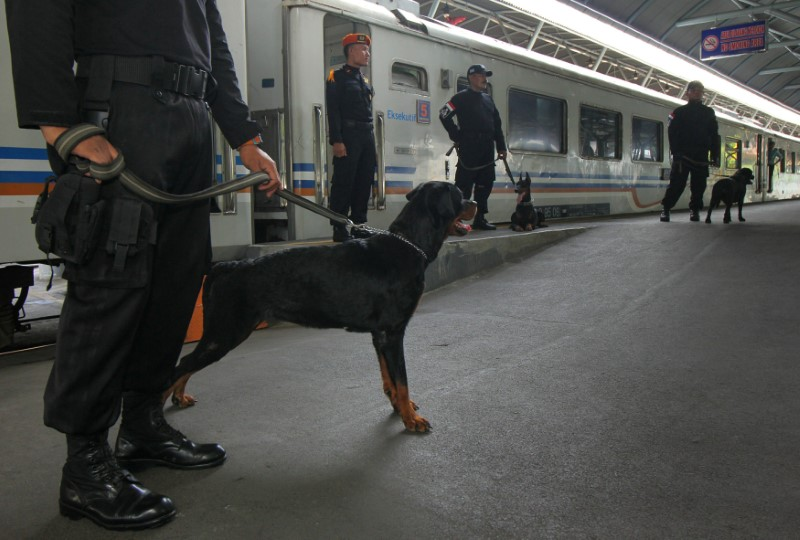 Indonesian police stand guard with their sniffer dogs providing security ahead of the Christmas and New Years holiday at Gubeng station, Surabaya, East Java, Indonesia December 23, 2016 in this photo taken