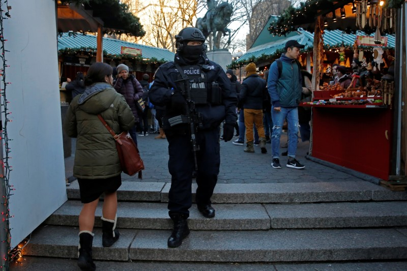 A member of the New York Police Department's Counterterrorism Bureau patrols the Union Square Holiday market following the Berlin Christmas market attacks in Manhattan, New York City