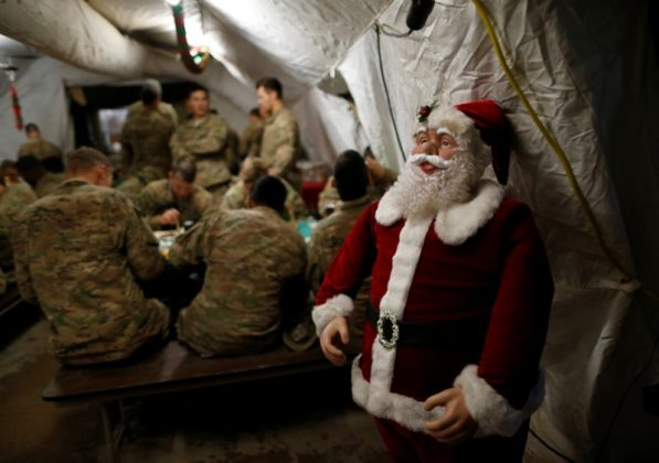 U.S. soldiers enjoy a Christmas dinner at an army base in Karamless town, east of Mosul,