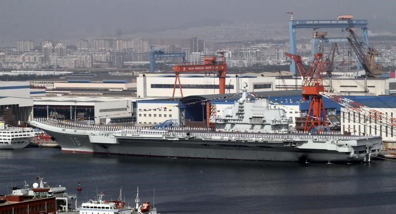"A general view shows navy soldiers standing on China's first aircraft carrier ""Liaoning"" as it is berthed in a port in Dalian, northeast China's Liaoning province,"