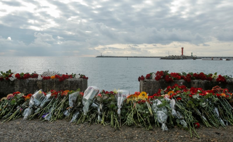 Flowers in memory of passengers and crew members of Russian military Tu-154, which crashed into the Black Sea on its way to Syria on Sunday, are placed at an embankment in the Black Sea resort city of Sochi, Russia