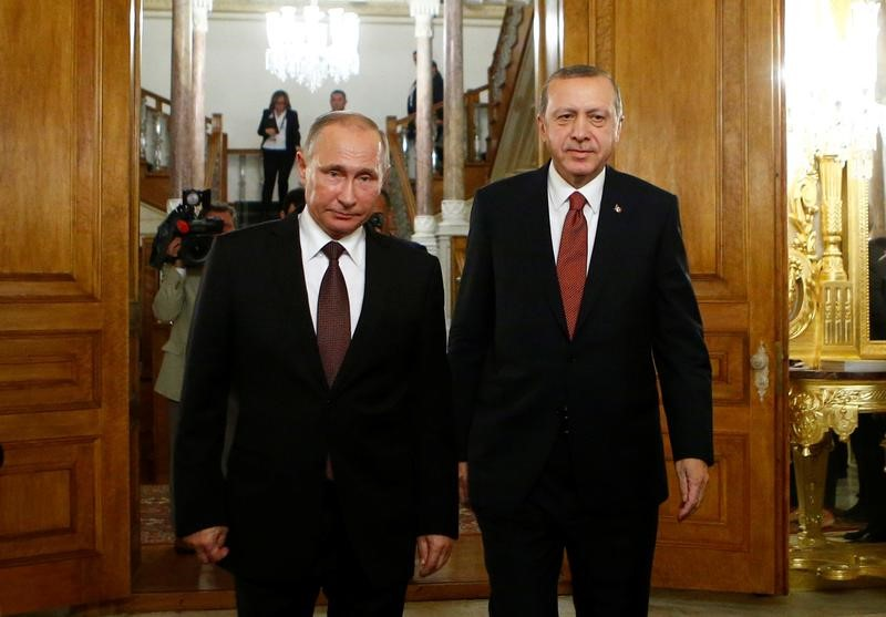 Russian President Vladimir Putin and his Turkish counterpart Tayyip Erdogan arrive for a joint news conference following their meeting in Istanbul, Turkey,