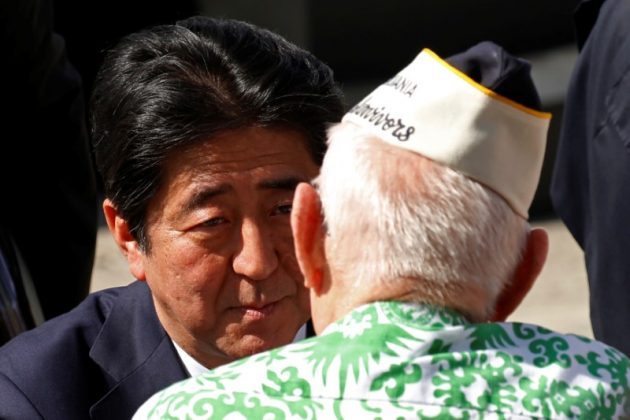 Japanese Prime Minister Shinzo Abe speaks with a Pearl Harbor survivor after he and U.S. President Barack Obama spoke at Joint Base Pearl Harbor-Hickam, Hawaii, U.S., December 27, 2016..