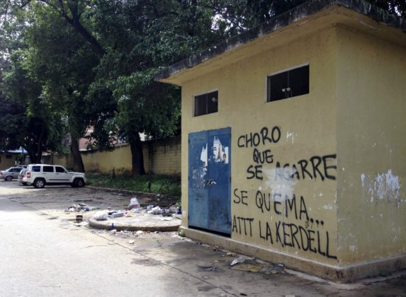 "A graffiti that reads ""Get ready, thief, here we burn you. Regards, Kerdell"" is seen at a residential block in Valencia, Venezuela, August 21, 2015. When a man they believed to be a thief sneaked into their parking lot in the Venezuelan city of Valencia, angry residents caught him, stripped him and beat him with fists, sticks and stones. They tied him up and doused him in gasoline, according to witnesses, in one of what rights groups and media reports say are an increasing number of mob beatings and lynchings in a country ravaged by crime. REUTERS/Alexandra Ulmer"
