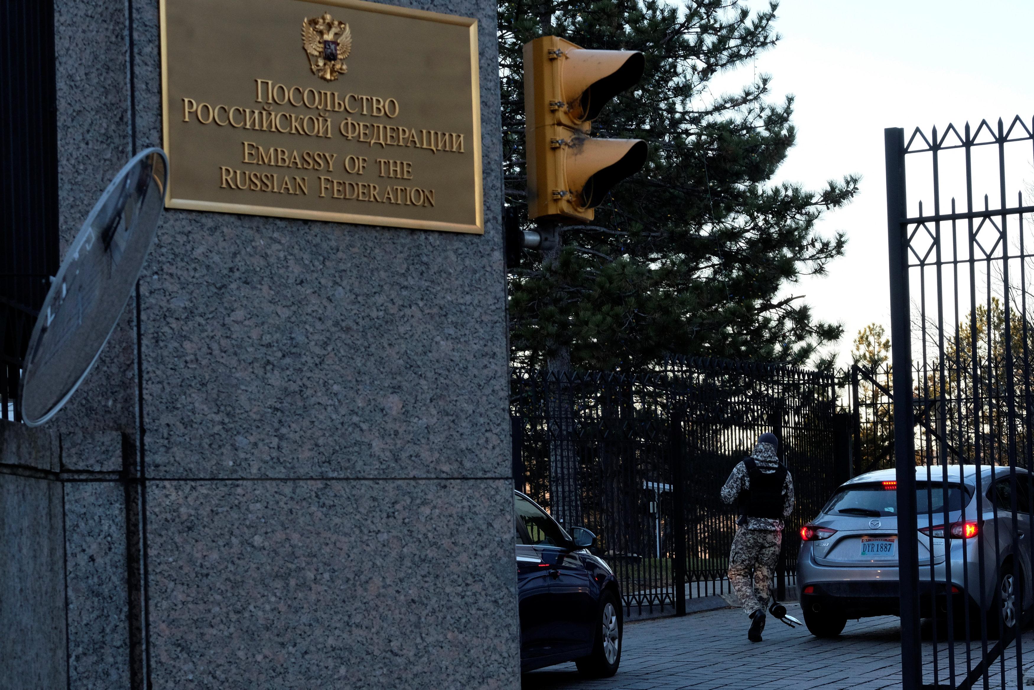 A guard screens cars entering the Russian embassy on Wisconsin Avenue in Washington, U.S.