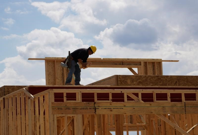 Workers construct a new house in Leyden Rock in Arvada, Colorado, U.S.