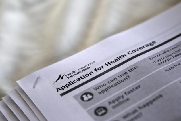 """The federal government forms for applying for health coverage are seen at a rally held by supporters of the Affordable Care Act, widely referred to as """"Obamacare"""", outside the Jackson-Hinds Comprehensive Health Center in Jackson, Mississippi, U.S"""