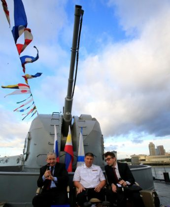 Russian Ambassador to the Philippines Igor Khovaev (L) and Rear Admiral Eduard Mikhailov (C), the deputy commander of Flotilla of Pacific Fleet of Russia, answer questions from the members of the media onboard the Russian Navy vessel, Admiral Tributs, a large anti-submarine ship, docked at the south harbor port area in metro Manila, Philippines