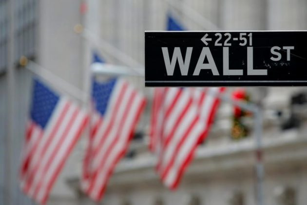 A street sign for Wall Street is seen outside the New York Stock Exchange (NYSE) in Manhattan, New York City, U.S. December 28, 201