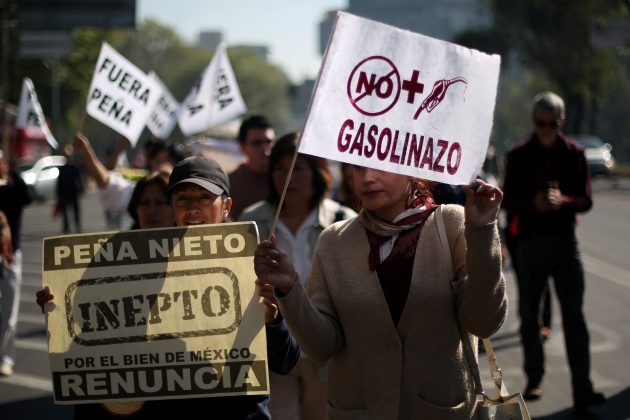 Demonstrators march after gas prices are raised in Mexico