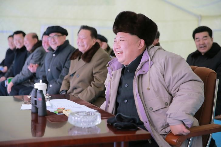 North Korea leader Kim Jong Un watching missile test