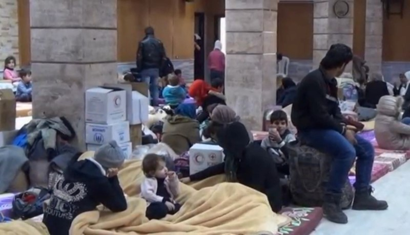 Civilians rescued from enemy fire in Damascus shelter short on supplies