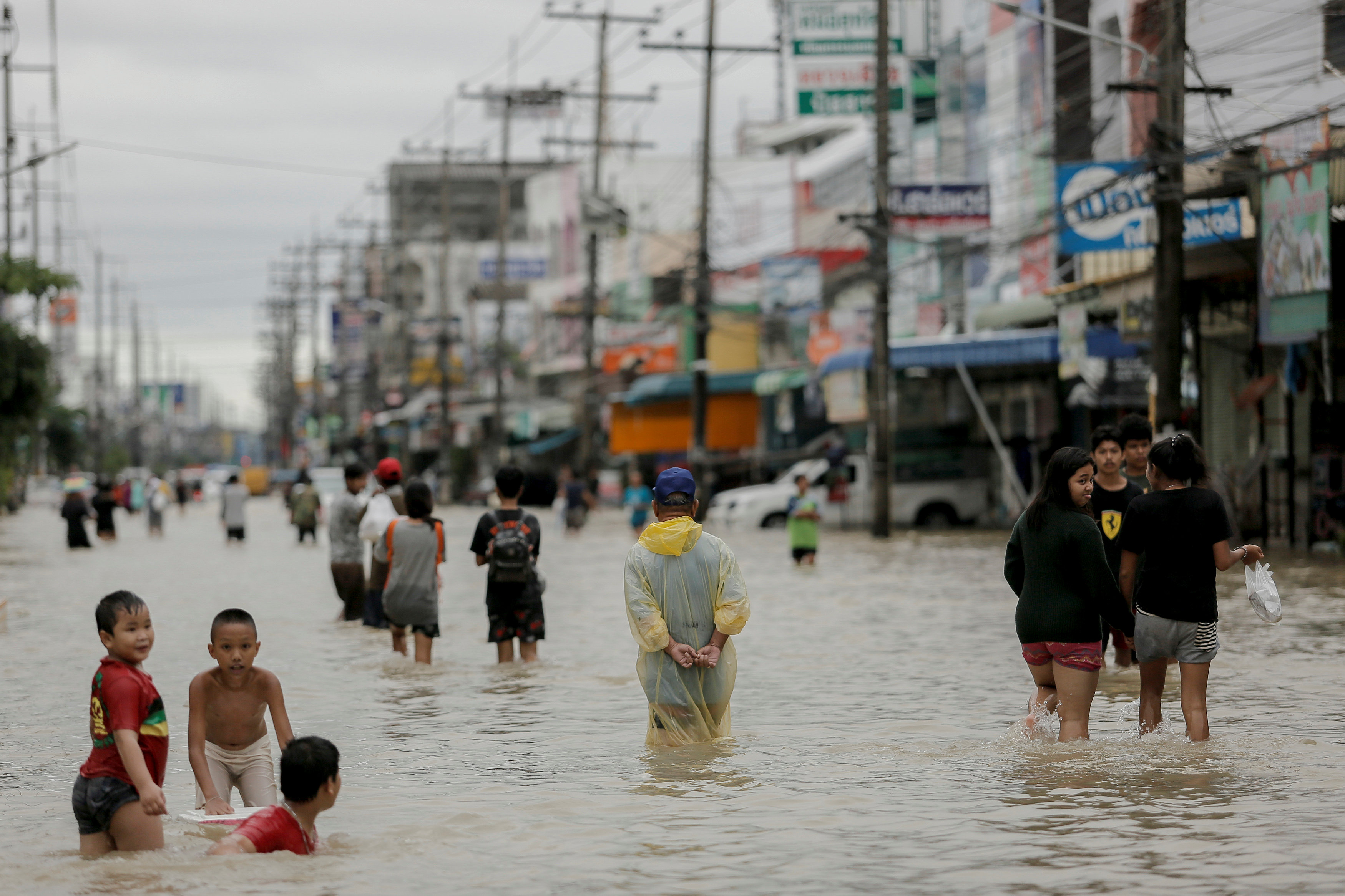 People in flood street in Thailand