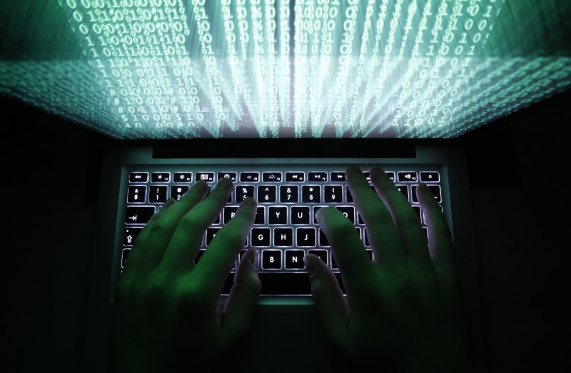 Man typing on keyboard representing cyber security threats