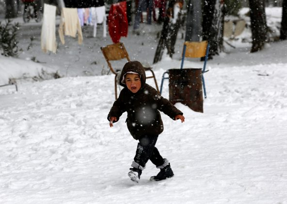 Syrian refugee boy in the snow