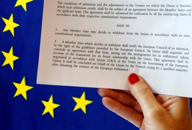 EU Lisbon Treaty near EU flag
