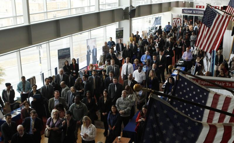 Job applicants listen to presentation for job opening at job fair