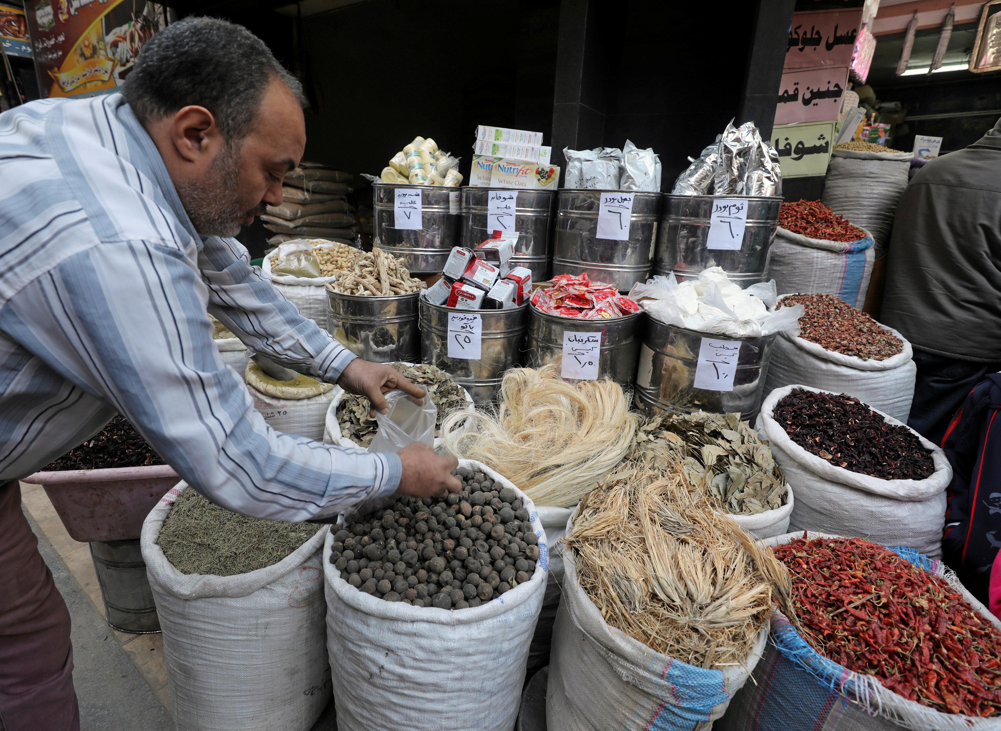 Herbal medicine worker taking spices to make medicine