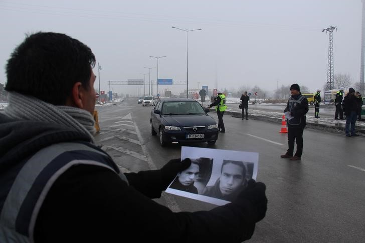 Turkey police holding pictures of suspects