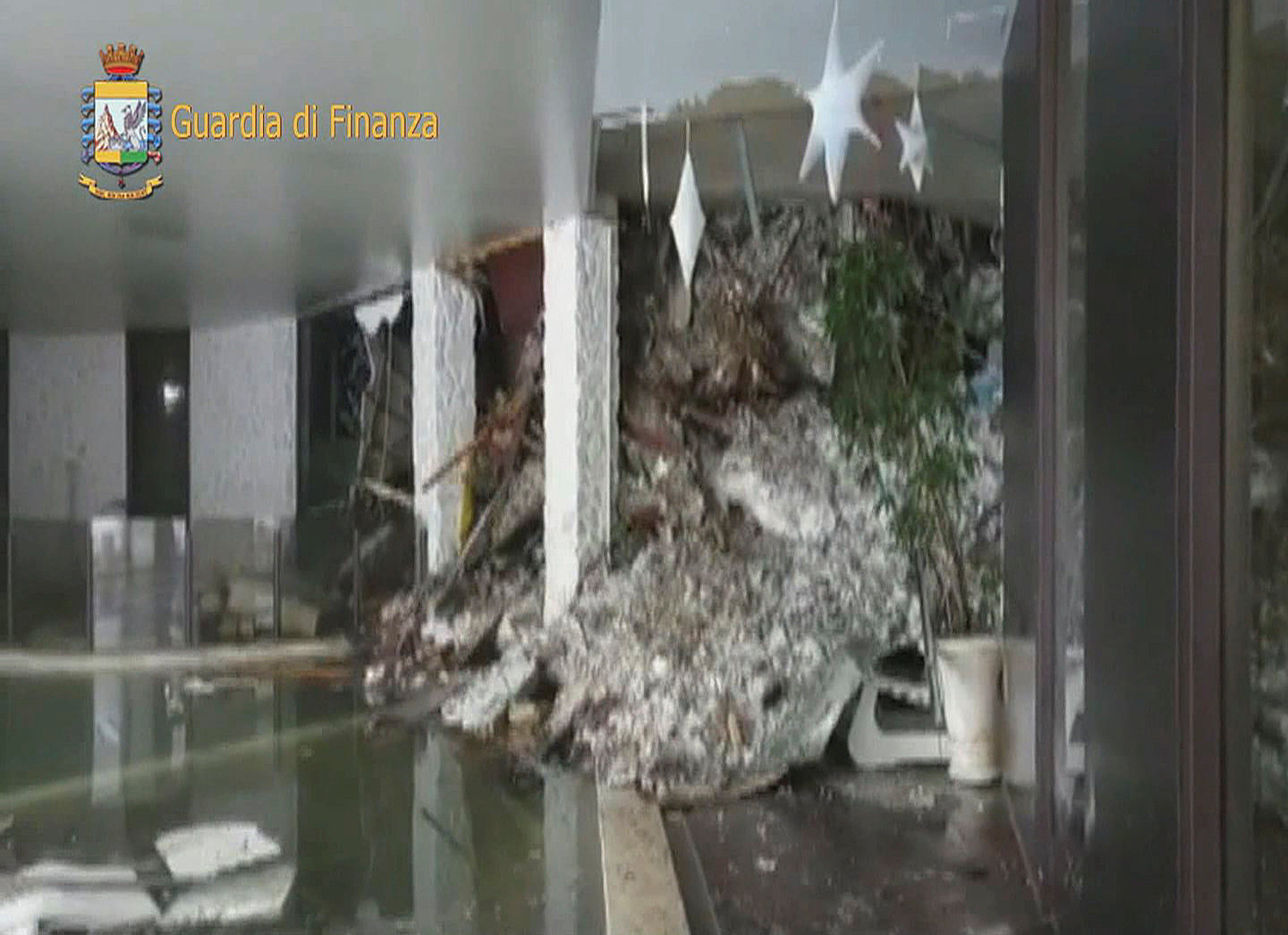 A photo taken from a video shows the snow inside the Hotel Rigopiano in Farindola, central Italy, hit by an avalanche, in this January 19, 2017 handout picture provided by Italy's Finance Police.