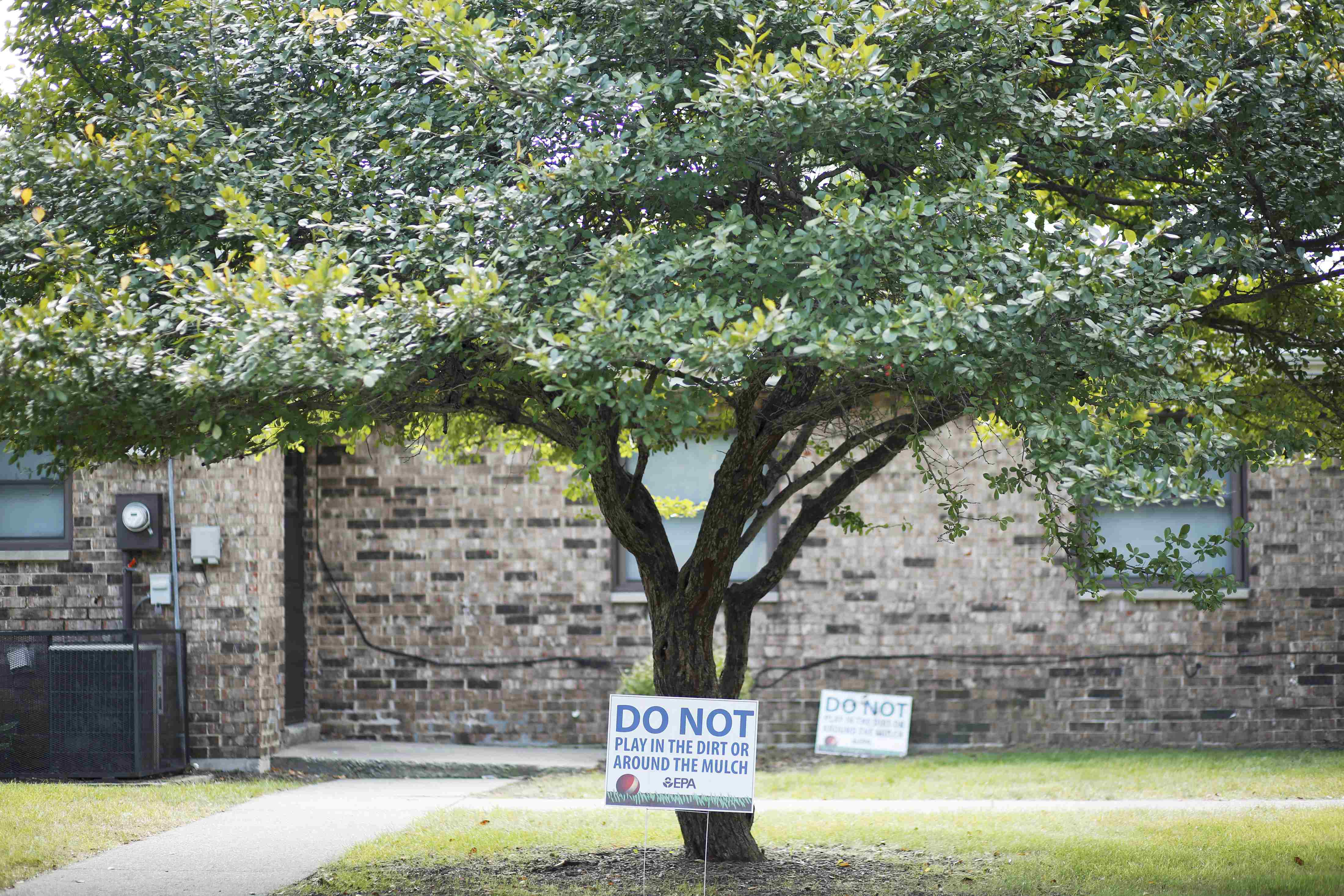 "Environmental Protection Agency signs that read ""DO NOT play in the dirt or around the mulch"" are seen at the West Calumet Complex in East Chicago, Indiana, U.S."