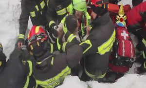 firefighters rescue survivor from Italy hotel that had an avalanche hit