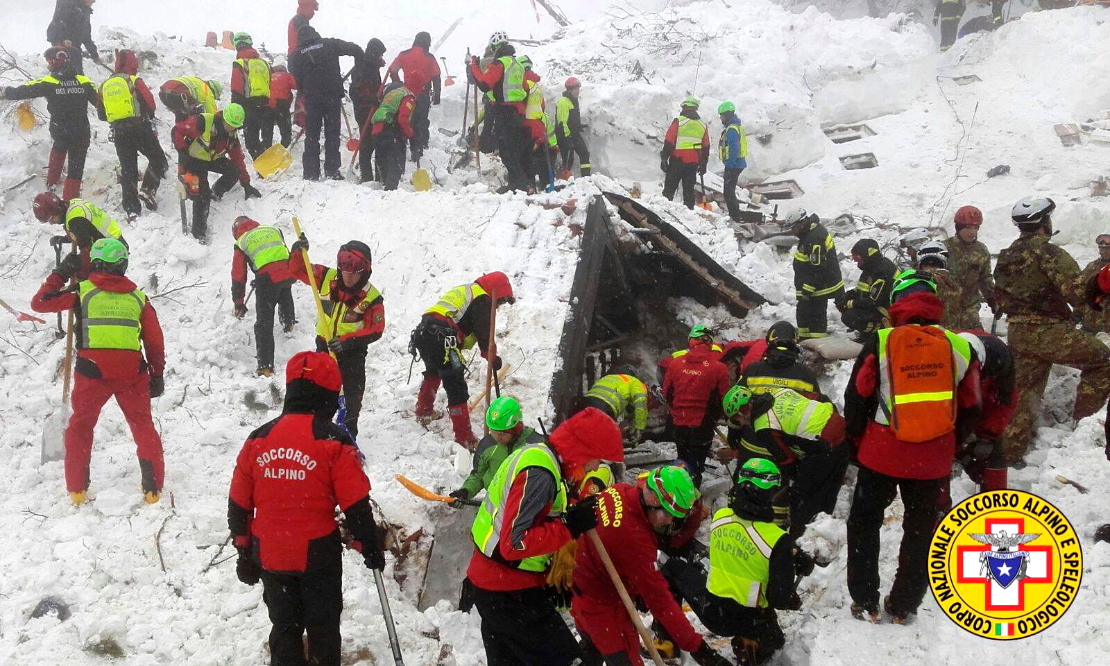 Rescue workers at Italy hotel that was covered after avalanche