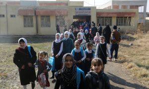 schoolchildren heading for schools after registering and receiving school bags