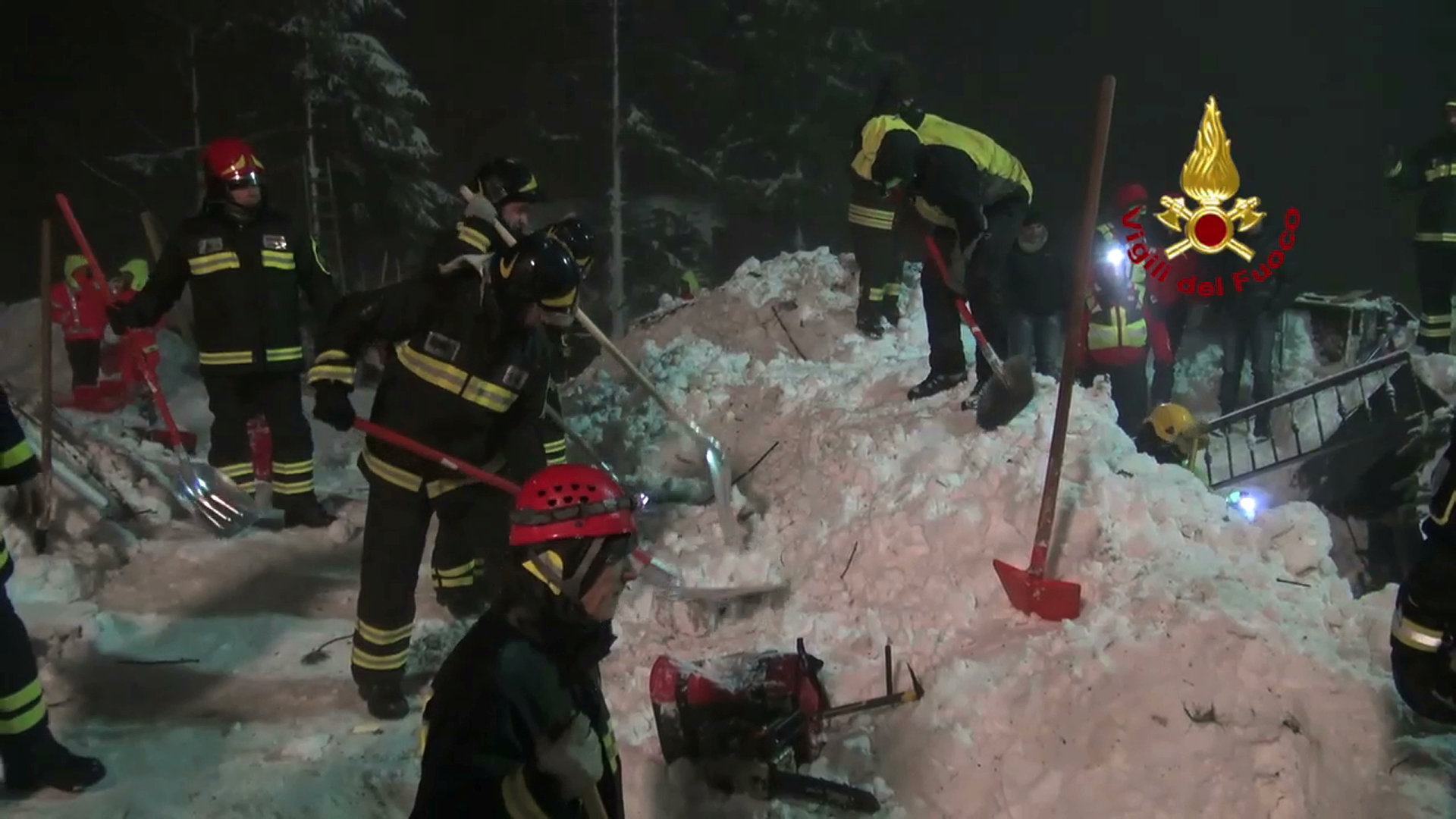 Italian firefighters working to save those buried in avalanche