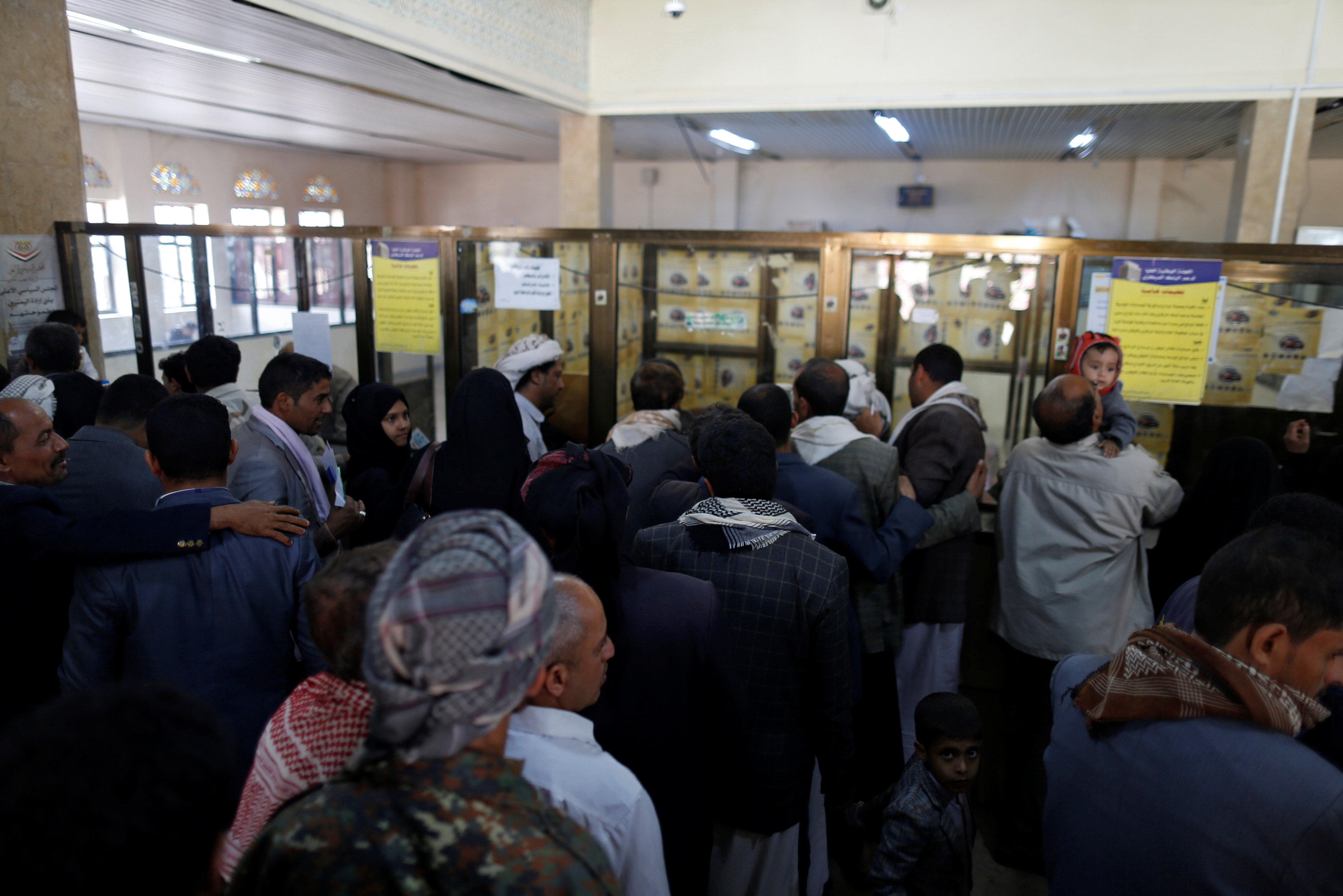public workers crowd post office to receive salaries