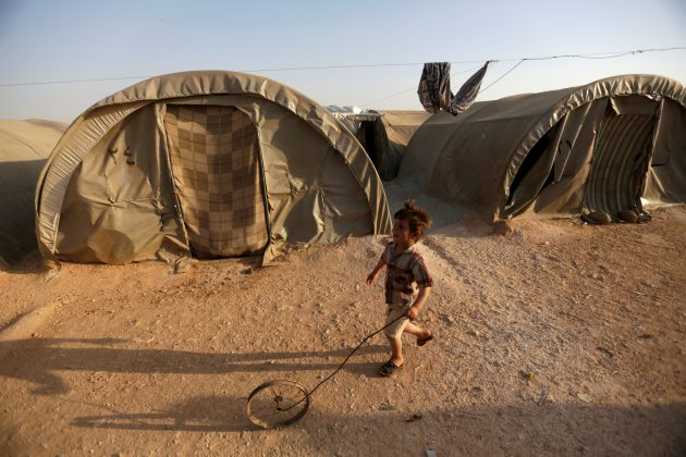 displace Syrian boy in refugee camp