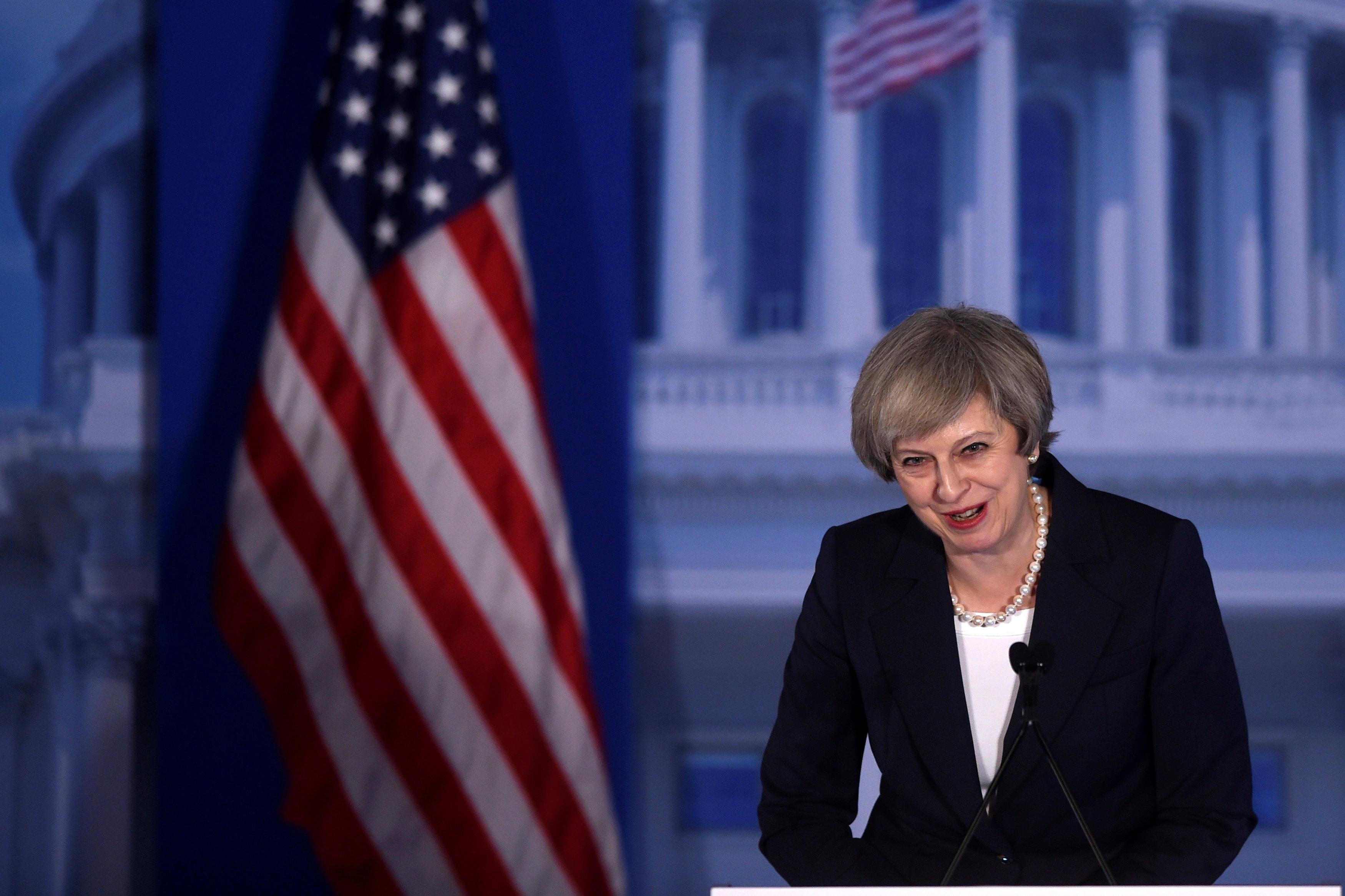 Theresa May before meeting Donald Trump