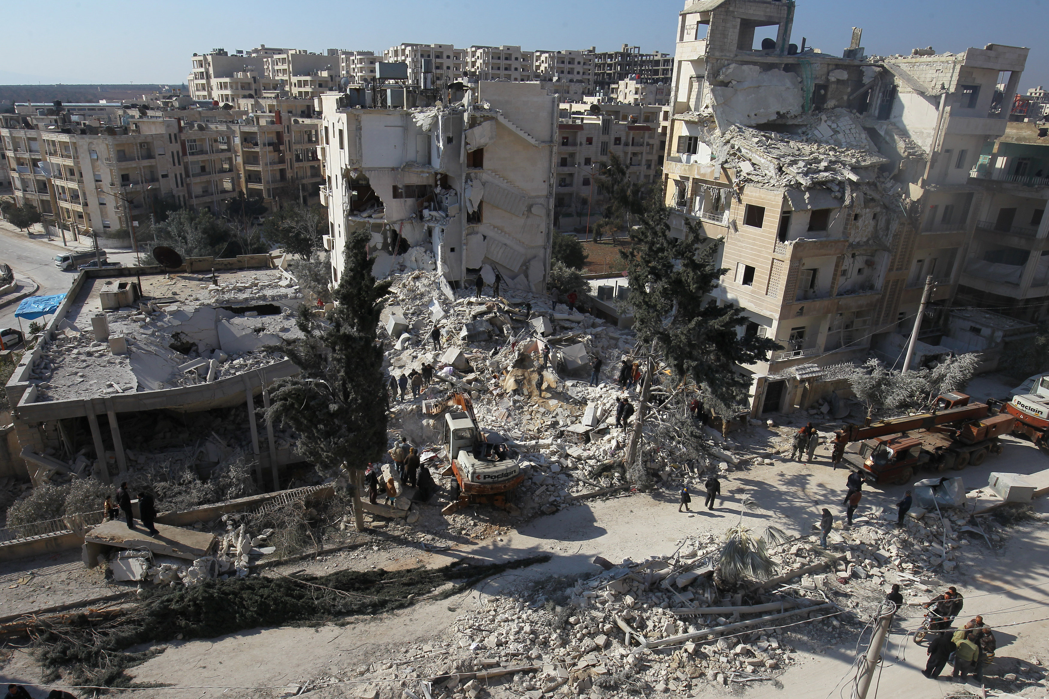people see debris of attack in Syria