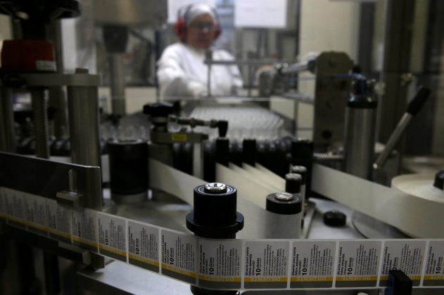 woman works on yellow fever vaccine