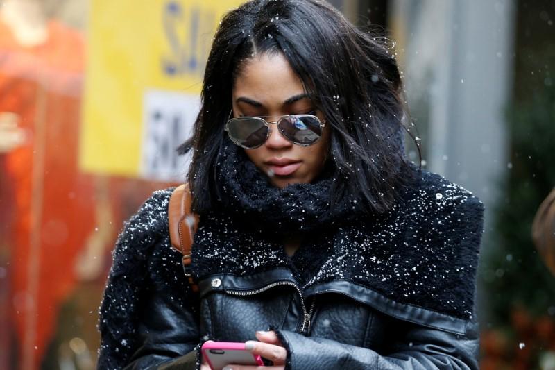 woman walks through snow in New York City