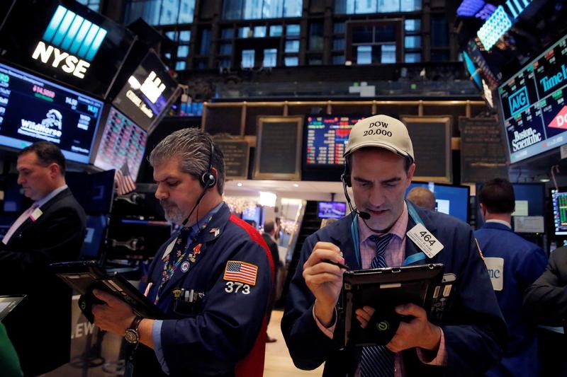 Traders work on the floor at the New York Stock Exchange (NYSE) in Manhattan, New York City, U.S.
