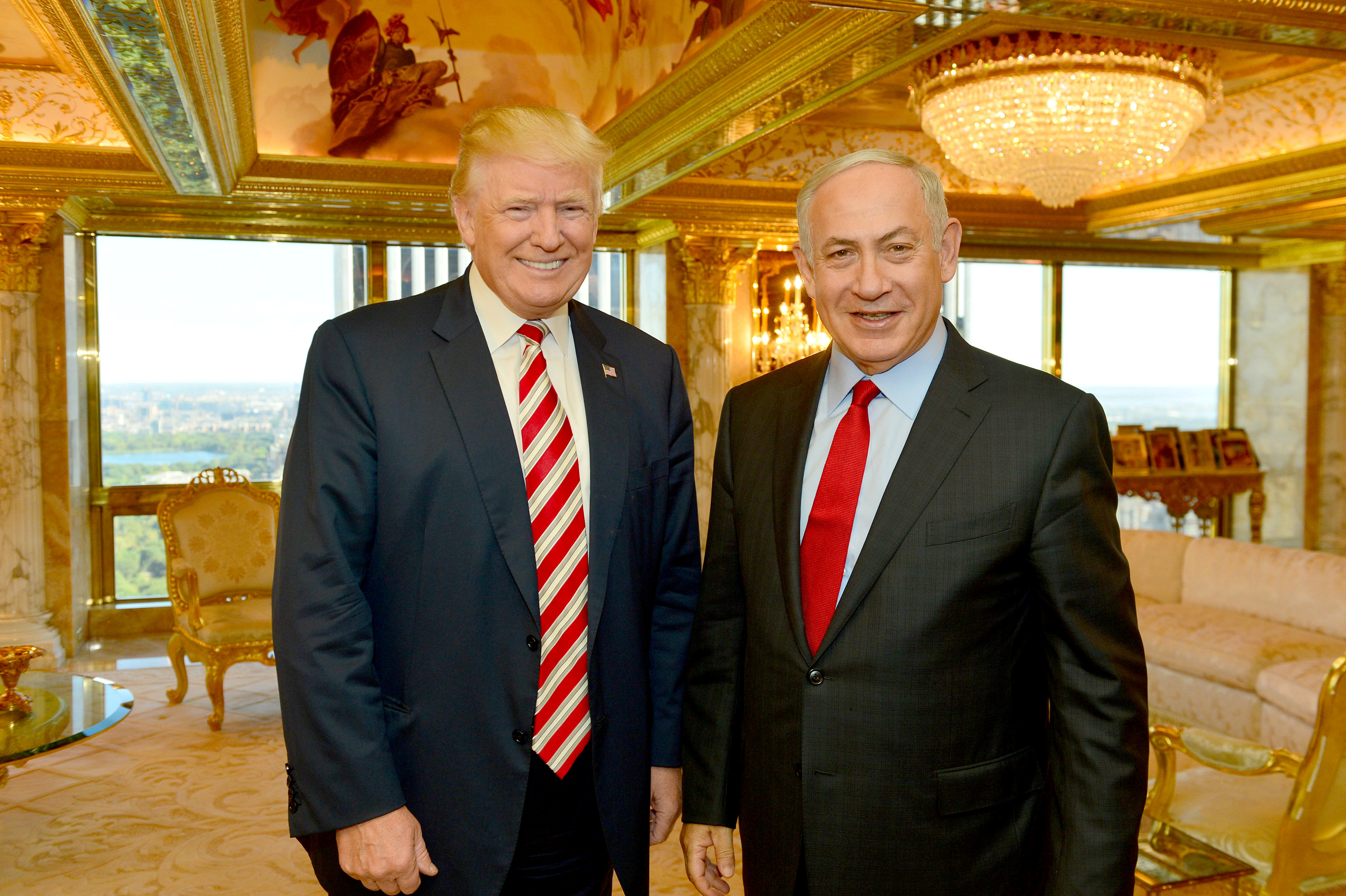 Israeli Prime Minister Benjamin Netanyahu (R) stands next to Republican U.S. presidential candidate Donald Trump during their meeting in New York, U.S.