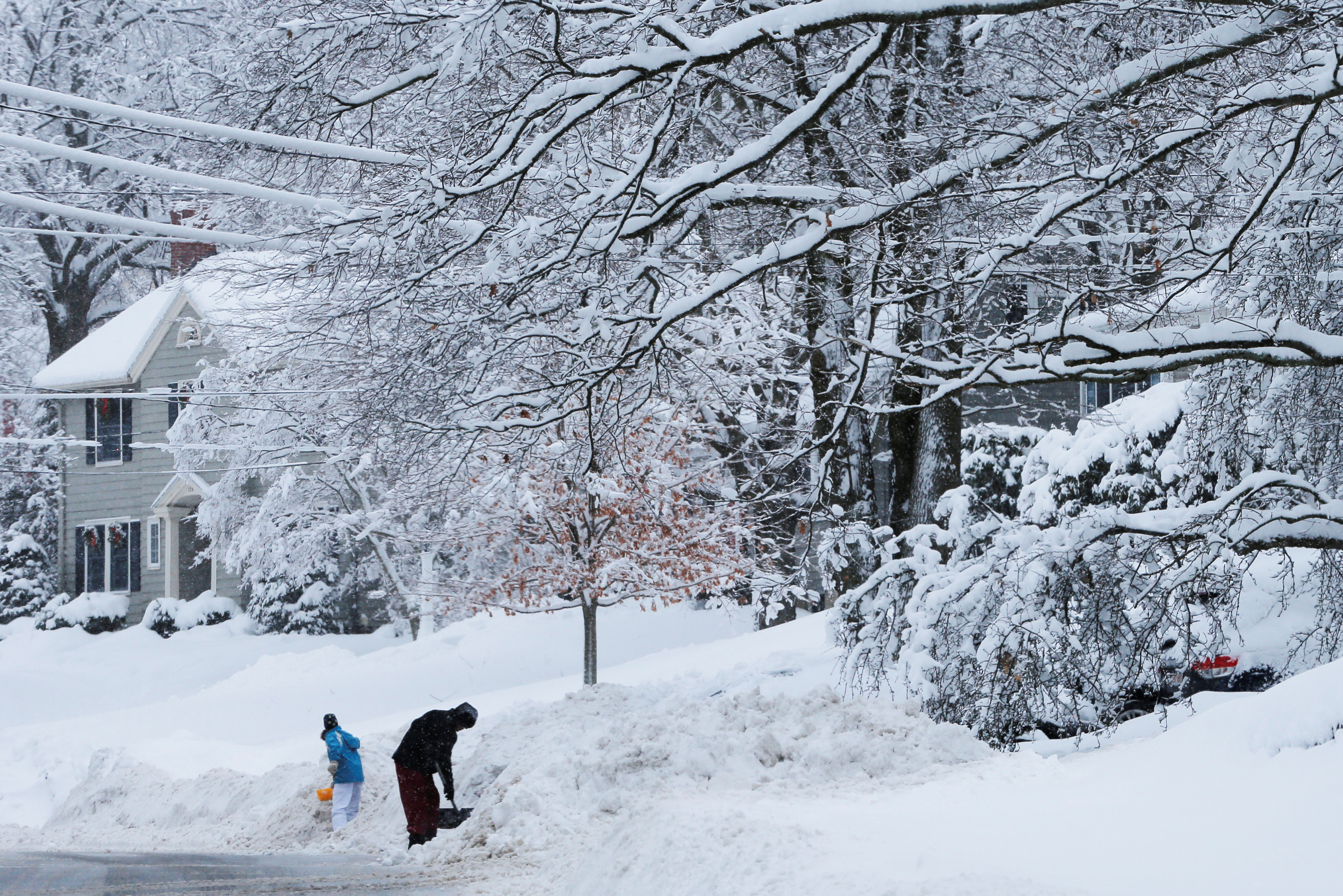 Residents dig out following a winter snow storm in the Boston suburb of Wakefield, Massachusetts, U.S.