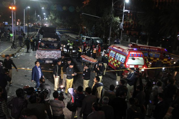 Police and rescue workers work at the scene of a blast in Lahore, Pakista