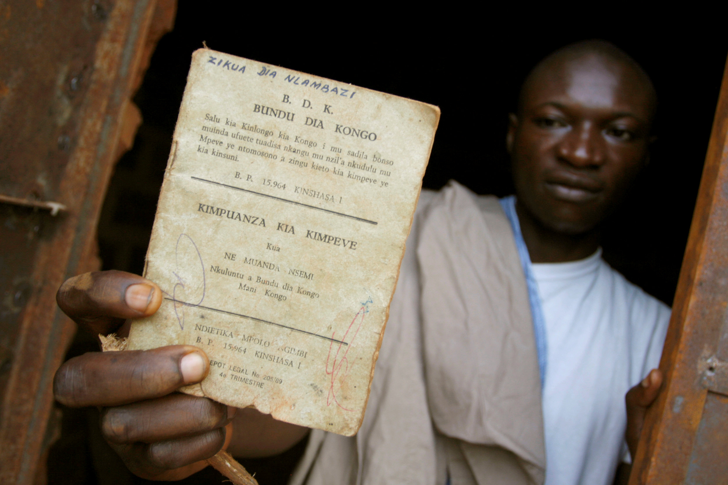 FILE PHOTO: A resident holds up a Bundu dia Kongo manifesto left behind after a police crackdown on the religious and political movement in Matadi, capital of Democratic Republic of Congo's volatile Bas Congo province, March 18, 2008.REUTERS/Joe Bavier/File Photo