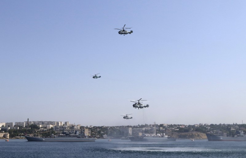 Russian military helicopters fly in formation