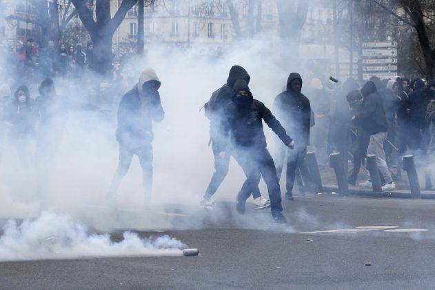 Clouds of tear gas surround youths as they face off with French police during a demonstration against police brutality after a young black man, 22-year-old youth worker named Theo, was severely injured during his arrest earlier this month, in Paris, France, February 23, 2017. REUTERS/Gonzalo Fuentes