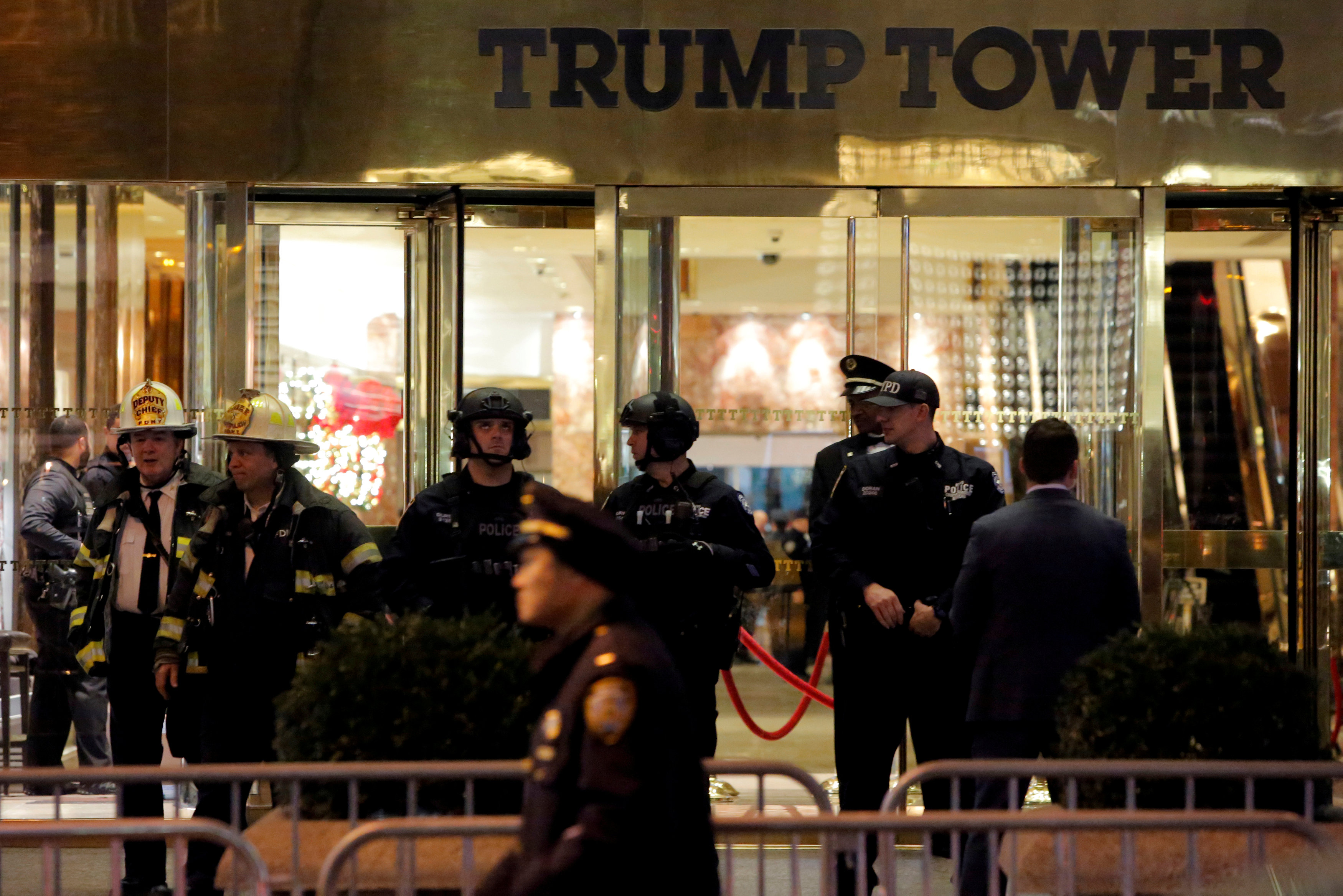 FILE PHOTO - Police and fire crew stand outside Trump Tower following a report of a suspicious package in Manhattan, New York City, U.S. on December 27, 2016. REUTERS/Andrew Kelly/File Photo