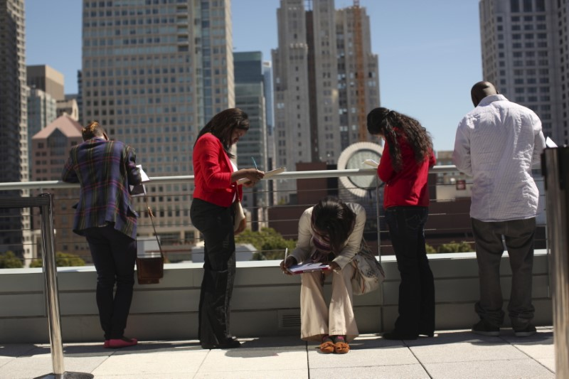 FILE PHOTO: Job seekers apply for the 300 available positions at a new Target retail store in San Francisco, California August 9, 2012. REUTERS/Robert Galbraith/File Photo