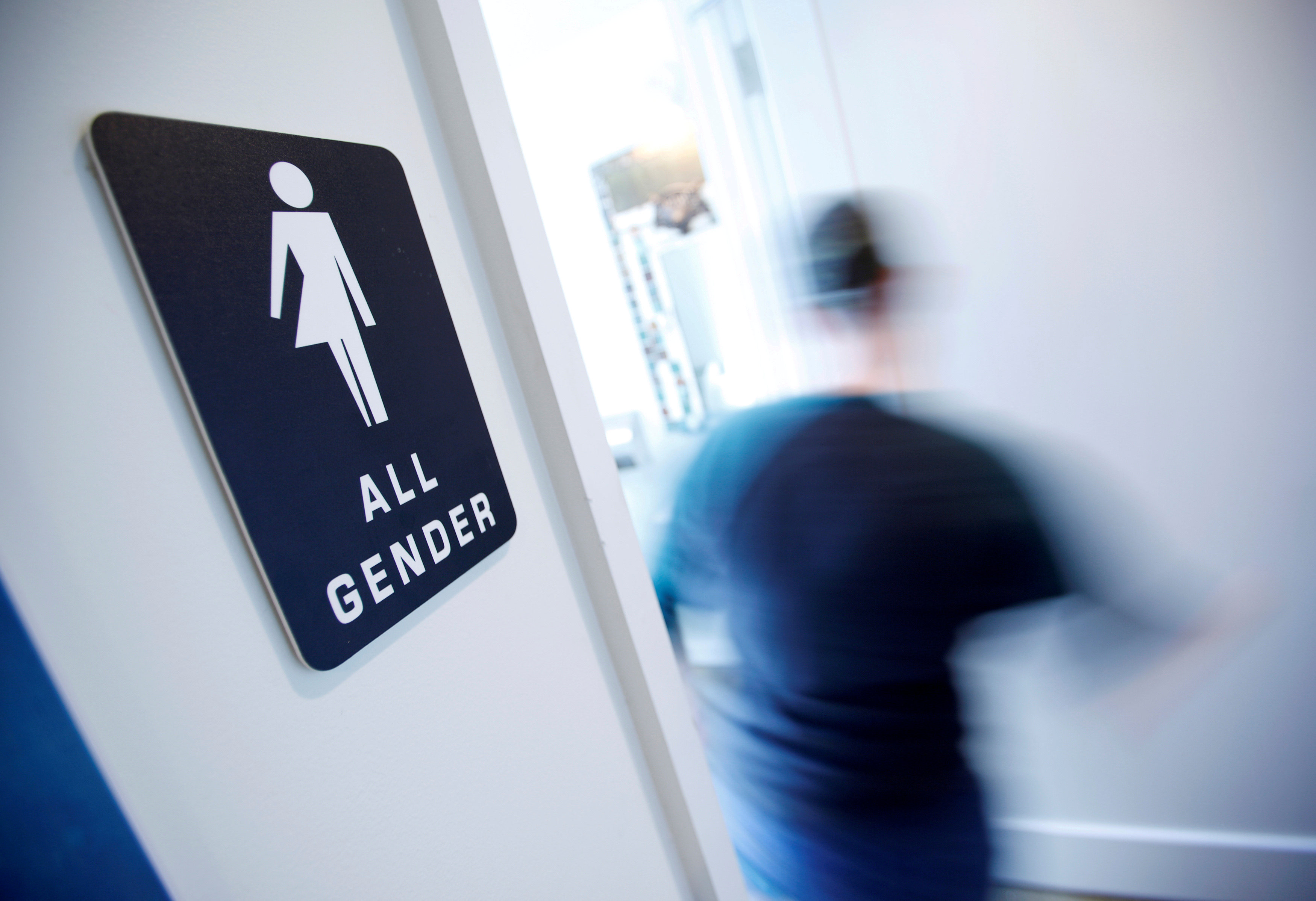 FILE PHOTO - A bathroom sign welcomes both genders at the Cacao Cinnamon coffee shop in Durham, North Carolina, United States on May 3, 2016. REUTERS/Jonathan Drake/File Photo