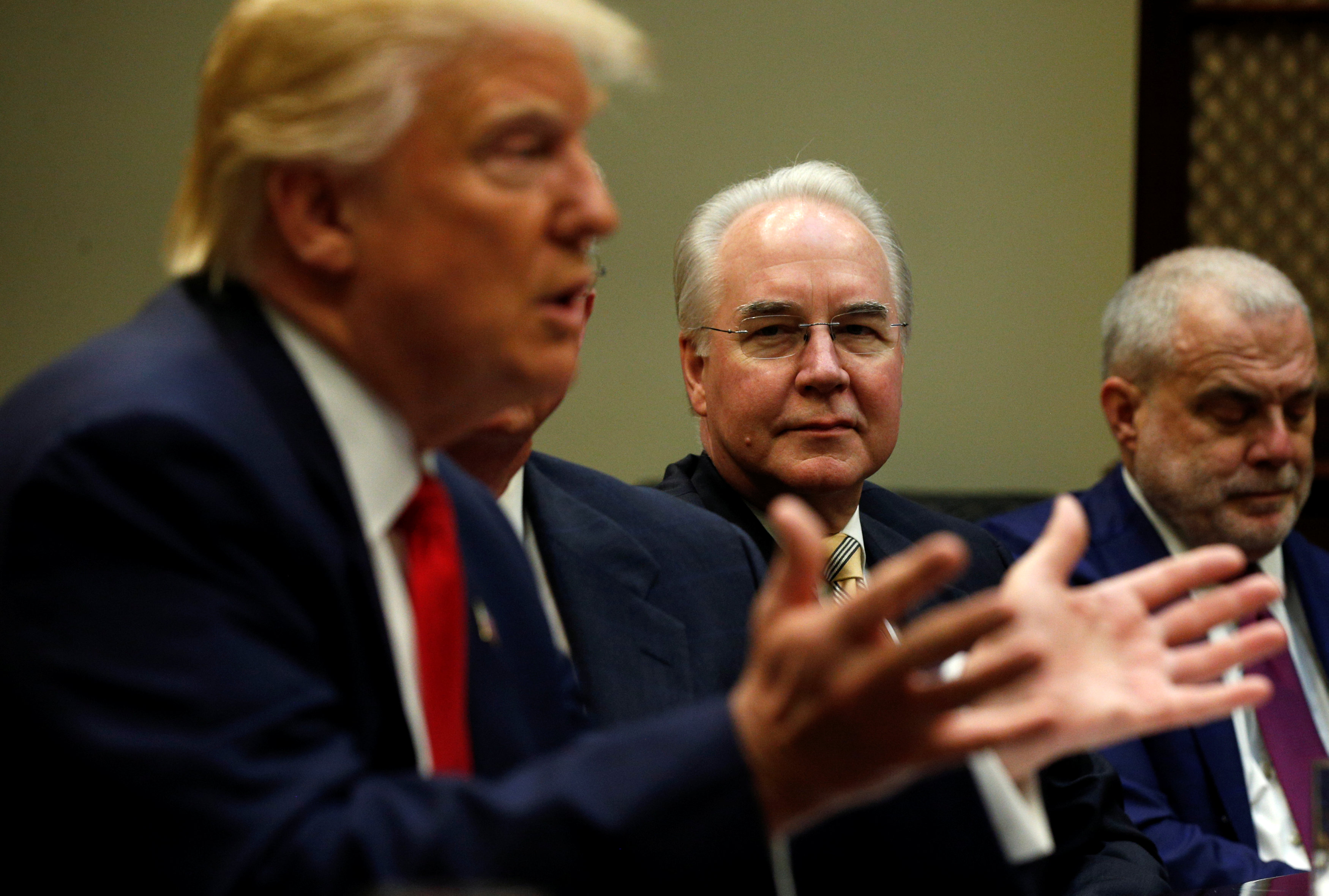 Health and Human Services Secretary Tom Price (C) and Aetna CEO Mark Bertolini (R) listen to U.S. President Donald Trump speak during a meeting with health insurance company CEOs at the White House in Washington, U.S.